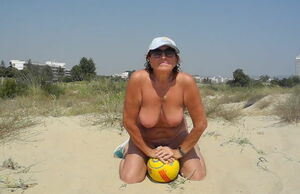 Bare with ball on the beach