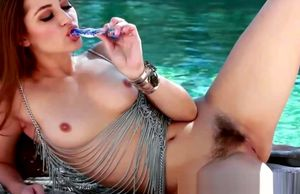 Fashionable Dani Daniels drains outdoors